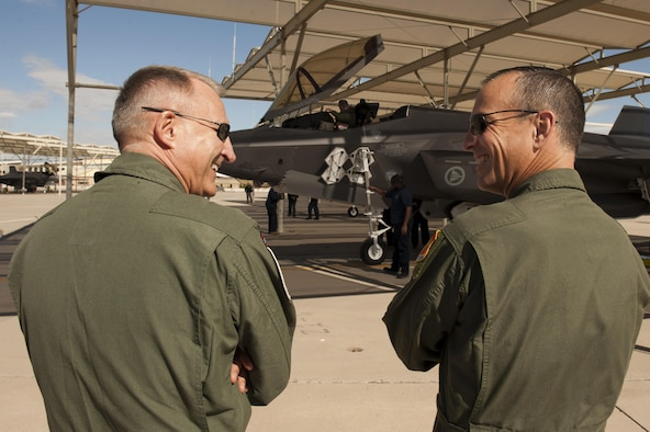 Maj. Gen. Morten Klever (left), program director of the Norwegian Fighter Aircraft Program, talks with Brig. Gen. Scott Pleus, 56th Fighter Wing commander as the first two Norwegian F-35s arrived at Luke Air Force Base, Arizona, Nov. 10, 2015. Shortly after, a Norwegian pilot flew the F-35 Lightning II for the first time, in conjunction with the Royal Norwegian air force's birthday. (U.S. Air Force photo by Staff Sgt. Staci Miller)