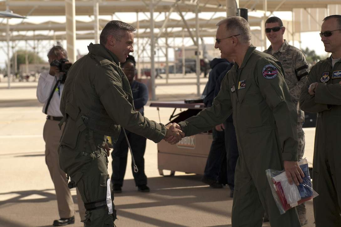 Maj. Gen. Morten Klever, program director of the Norwegian Fighter Aircraft Program, accepts the first two Norwegian F-35s after they arrived at Luke Air Force Base, Arizona, Nov. 10, 2015. Shortly after, a Norwegian pilot flew the F-35 Lightning II for the first time, in conjunction with the Royal Norwegian air force's birthday.