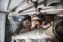 Senior Airman Jesse Anocibar, a 455th Expeditionary Aircraft Maintenance Squadron crew chief deployed from Dyess Air Force Base, Texas, removes a bolt on a C-130 Hercules at Bagram Airfield, Afghanistan, Nov. 13, 2015. The 455th EAMXS is responsible for repairing and maintaining military aircraft on Bagram, as well as performing preventative maintenance inspections. (U.S. Air Force photo/Tech. Sgt. Robert Cloys)