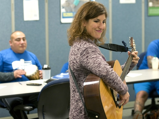 Nicki Rubin, a music therapist, encourages wounded Airmen to interact during a music therapy session Nov. 19, 2015, on Joint Base Andrews, Md., as part of Warrior Care Month. Airmen had the chance to use a variety of musical instruments and collaborate on songs in the sessions, which were intended to show wounded warriors a unique approach to therapy. (U.S. Air Force photo/Sean Kimmons)