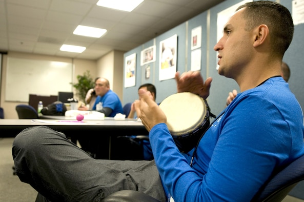 First Sgt. Estevan Vigil taps a bongo as he sings along with other wounded Airmen during a music therapy session Nov. 19, 2015, on Joint Base Andrews, Md., as part of Warrior Care Month. Airmen had the chance to use a variety of musical instruments and collaborate on songs in the sessions, which were intended to show wounded warriors a unique approach to therapy. (U.S. Air Force photo/Sean Kimmons)
