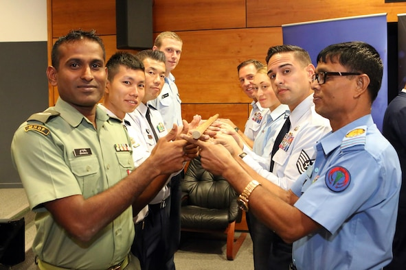 U.S. Air Force Tech. Sgt Luis Reyes (right side, second from front), 36th Wing Command Chief executive assistant, conducts a leadership challenge with Pacific Region Junior Enlisted Airmen at the first Pacific Rim Junior Enlisted Leadership Forum in Canberra, Australia, Sept. 29, 2015. Reyes joined Airmen from 12 countries to share experiences and learn about each other's leadership techniques and improve leadership growth and partnerships in the forum.  (Courtesy photo)