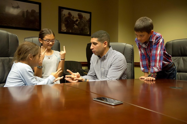 Retired Army Capt. Florent Groberg, a Medal of Honor recipient, plays rock-paper-scissors with Ava Gray, as her sister, Nyah, keeps score and her brother, Garrett, watches inside the Pentagon in Washington, D.C., Nov. 9, 2015. Groberg was with Maj. David Gray, the children's father, when he was killed in action Aug. 8, 2012, during a deployment to Afghanistan. The family was together at the Pentagon for a Flag for Hope event. (U.S. Air Force photo/Staff Sgt. Christopher Gross)
