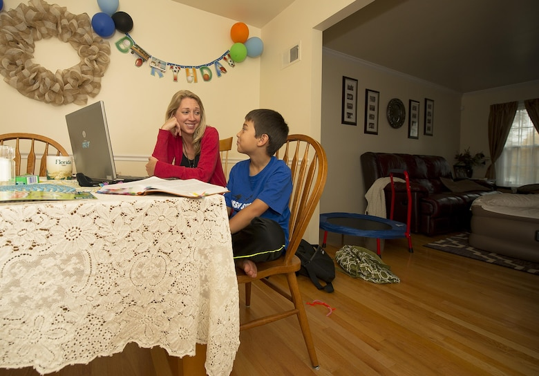 Heather Gray teaches her son, Garrett, 9, during a home school session Nov. 10, 2015, at a friend's house in Virginia. Heather started home schooling her children at the start of this school year. Heather and her three children moved from Colorado, where her husband David was stationed at Fort Carson, earlier this year for the first time since his death. (U.S. Air Force photo/Staff Sgt. Christopher Gross)