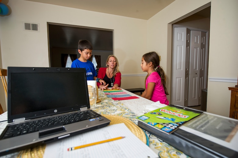 Heather Gray (middle) goes over how to properly conduct an experiment with her children Garrett, 9, and Ava, 7, during a home school session Nov. 10, 2015, at a friend's house in Virginia. Heather started home schooling her children at the start of this school year. Heather and her three children moved from Colorado, where her husband David was stationed at Fort Carson, earlier this year for the first time since his death. (U.S. Air Force photo/Staff Sgt. Christopher Gross)