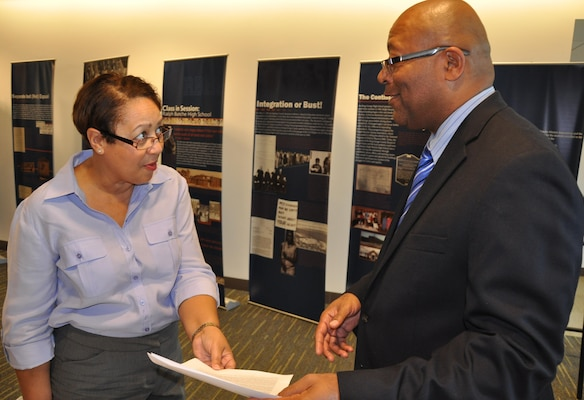 "DAHLGREN, Va. - Marietto Jeffries, NSWCDD Veterans Employment Special Emphasis Program Manager, explains his role in assisting veterans at Dahlgren to Sharon Rhone during the command's Disability Awareness Event and Health Fair at the University of Mary Washington, Dahlgren Campus, Oct. 29. Rhone is the Rural Health Integrator for the Rural Health Initiative Program at McGuire Veterans Administration Medical Center, Richmond, Va. Jeffries serves as a liaison between veterans who are government employees and workforce management and as their liaison to veterans associations. ""As a bridge between veterans on base and Veterans Administration resources, I educate veterans on how to get their disability and educational benefits,"" said Jeffries."