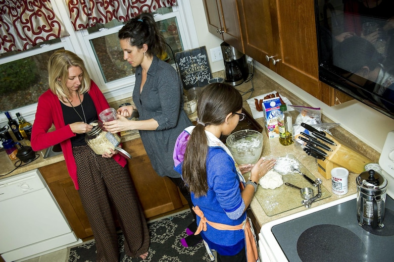 Nyah Gray, 11, makes biscuits during a home school lesson as her mother, Heather (left), and family friend, Jill, prepare ingredients Nov. 10, 2015, at a friend's house in Virginia. Heather started home schooling her children at the start of this school year. Heather and her three children moved from Colorado, where her husband David was stationed at Fort Carson, earlier this year for the first time since his death. (U.S. Air Force photo/Staff Sgt. Christopher Gross)