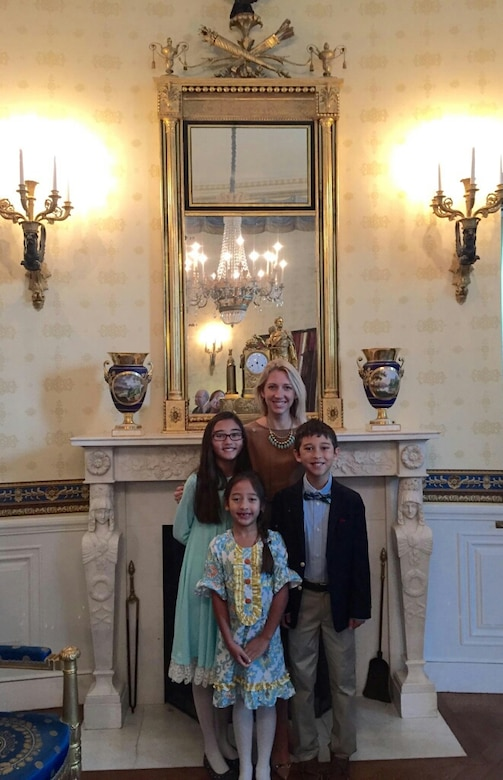 Heather Gray and her children, Nyah, Ava and Garrett, attend the Medal of Honor presentation for retired Army Capt. Florent Groberg at the White House Nov. 12, 2015. Groberg was with Heather's husband, Maj. David Gray, when he was killed in action Aug. 8, 2012, during a deployment to Afghanistan. (Courtesy photo)