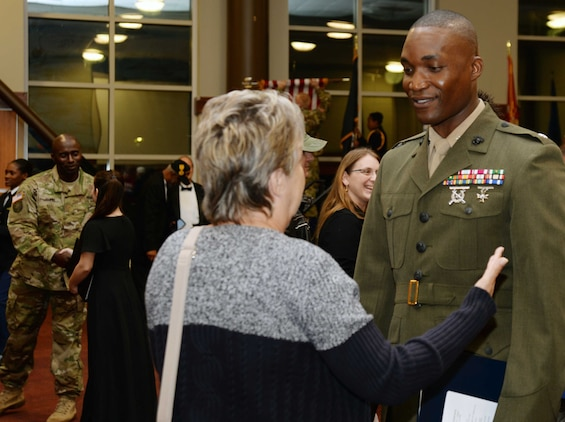 Lt. Col. Nathaniel Robinson, executive officer, Marine Corps Logistics Base Albany, visits with a participant following the Veterans Day ceremony at Darton State College, Albany, Georgia, Nov. 10.