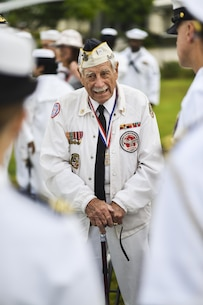 Pearl Harbor survivor, Delton E. Walling, speaks with the attendees during the Pearl Harbor Colors, Honors and Heritage Ceremony at the World War II Valor in the Pacific National Monument, Hawaii, Nov. 19, 2015. The ceremony is held once a month to honor the sacrifices of our armed forces, both those serving now and those have served.