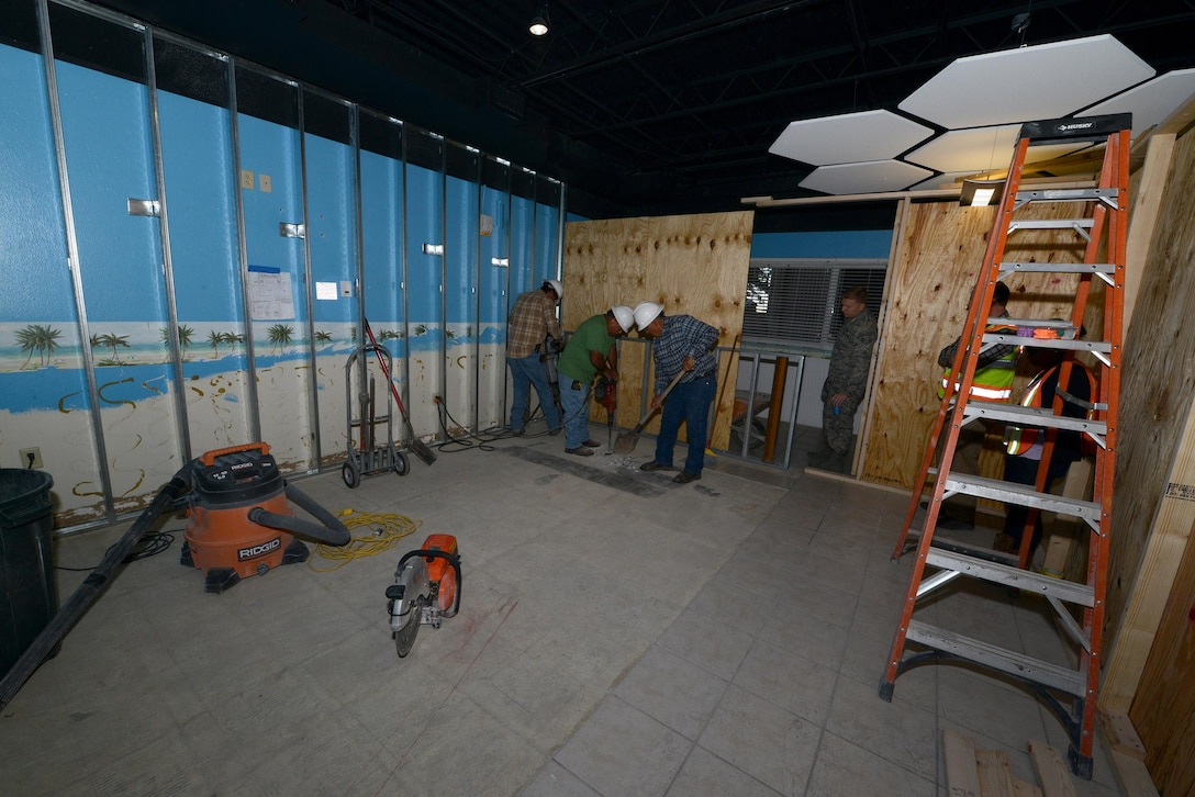 Contractors work on the enlisted dormitories dayroom at Laughlin Air Force Base, Texas, Nov. 19, 2015. The renovation project took nearly six months to plan and is scheduled to be completed by the end of January 2016. (U.S. Air Force photo by Airman 1st Class Ariel D. Partlow)
