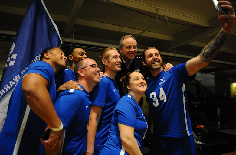 Air Force Chief of Staff Gen. Mark A. Welsh III takes a selfie with Air Force wounded warriors after they won the Warrior Care Month Sitting Volleyball Tournament championship match at the Pentagon in Washington, D.C., Nov. 19, 2015. The Air Force team edged out the Marines in the final match. (U.S. Air Force photo/Senior Airman Hailey Haux)