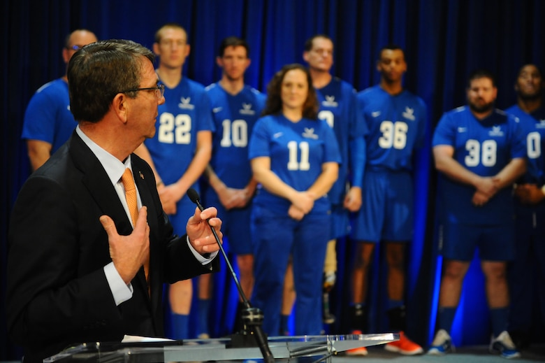 Defense Secretary Ash Carter speaks to a crowd of fans at the trophy presentation during the Warrior Care Month Sitting Volleyball Tournament at the Pentagon in Washington D.C., Nov. 19, 2015. The Air Force team edged out the Marines in the final match. (U.S. Air Force photo/Senior Airman Hailey Haux)