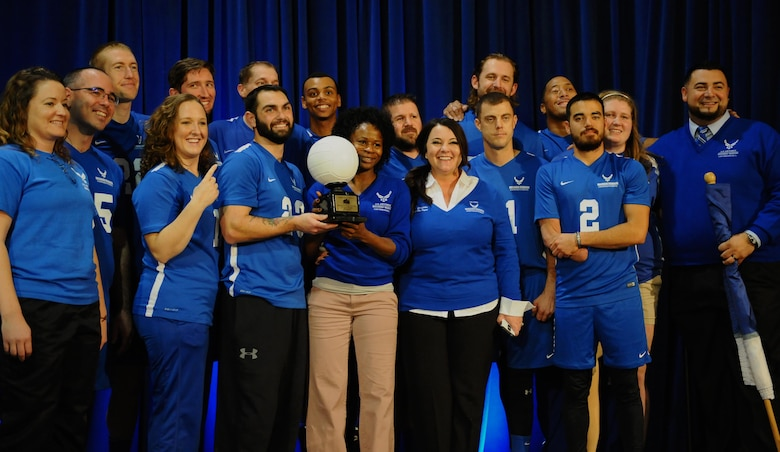 The Air Force Wounded Warrior Team pose for photos with the 1st place trophy after winning the Warrior Care Month Sitting Volleyball Tournament championship game at the Pentagon in Washington, D.C., Nov. 19, 2015. The Air Force edged out the Marines during the final match. (U.S. Air Force photo/Senior Airman Hailey Haux)