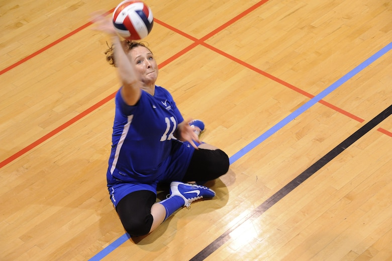 Retired Tech. Sgt. Melissa Monreau serves the ball during a match as part of the Warrior Care Month Sitting Volleyball Tournament at the Pentagon in Washington, D.C., Nov. 19, 2015. The Air Force won this year's tournament. (U.S. Air Force photo/Staff Sgt. Whitney Stanfield)