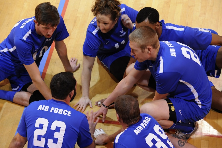 The Air Force Wounded Warrior Team discuss strategy during a timeout in the Warrior Care Month Sitting Volleyball Tournament at the Pentagon in Washington, D.C., Nov. 19, 2015. The Air Force Wounded Warrior Team won the match against the Marines, and went on to take home the trophy for the tournament. (U.S. Air Force photo/Staff Sgt. Whitney Stanfield)