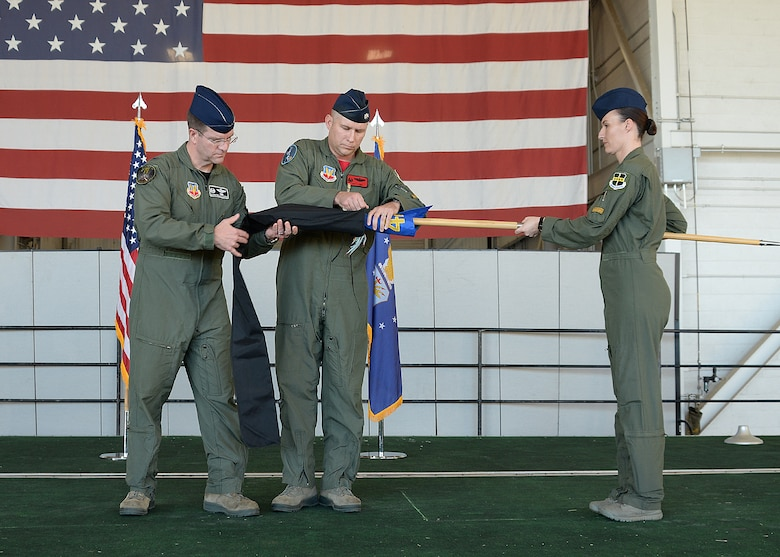 Col. Darren B. Halford, 9th Operations Group commander and Lt. Col. Joseph Laws, 427th Reconnaissance Squadron commander, case the unit flag during an inactivation ceremony Nov. 20, 2015, at Beale Air Force Base, California.  MC-12W Liberty Airmen from the past and present attended the ceremony and reception to reminisce about their time supporting the MC-12 mission. Since May 2012, the 427th RS has deployed and trained 455 Airmen, flown 4,770 combat missions, eliminated 503 enemy combatants, and saved countless coalition lives. (U.S. Air Force photo by Robert Scott)