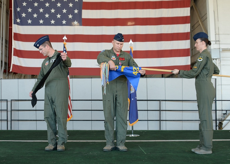 Col. Darren B. Halford, 9th Operations Group commander and Lt. Col. Joseph Laws, 427th Reconnaissance Squadron commander, prepare to case the unit flag during an inactivation ceremony Nov. 20, 2015, at Beale Air Force Base, California.  MC-12W Liberty Airmen from the past and present attended the ceremony and reception to reminisce about their time supporting the MC-12 mission. Since May 2012, the 427th RS has deployed and trained 455 Airmen, flown 4,770 combat missions, eliminated 503 enemy combatants, and saved countless coalition lives. (U.S. Air Force photo by Robert Scott)