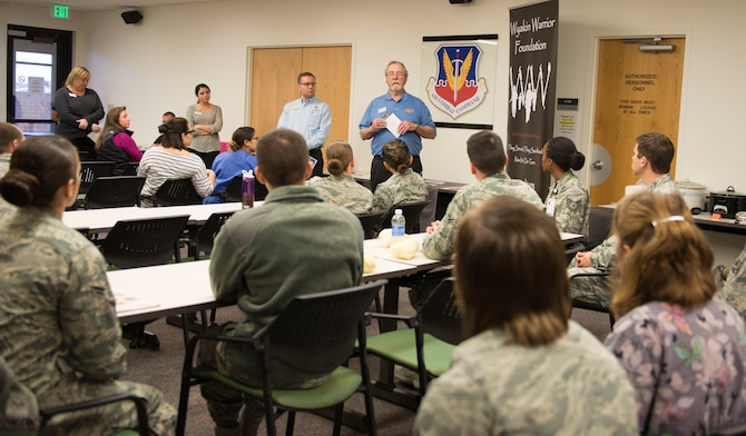 Retired Army Chief Warrant Office 3 Clifford Gaston, Wyakin Warrior Foundation senior development advisor, speaks to Department of Defense employees during a Combined Federal Campaign Charity Fair Nov. 17, 2015, at Mountain Home Air Force Base, Idaho. The CFC is known to be the most inclusive workplace giving campaign in the world with over 20,000 participating nonprofit charitable organizations worldwide. (U.S. Air Force photo by Airman Chester Mientkiewicz)