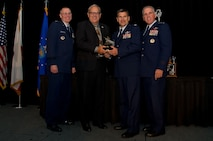 (L-R) Maj. Gen. Kenneth D. Lewis, Jr., director, Air, Space and Information Operations, Air Force Reserve Command, Robins Air Force Base, Georgia; Roger Rupp, Boeing Company and chair, Greater Riverside Chambers of Commerce Military Affairs Committee, Riverside, California; Col. Albert Lupenski, commander, 439th Airlift Wing, Westover Air Reserve Base, Massachusetts; and Maj. Gen. John C. Flournoy, Jr., commander Fourth Air Force, gather at the 16th Annual Raincross Trophy Dinner Nov. 19, 2015, to present the Raincross Trophy, signifying the best wing in the numbered Air Force, to the 439 AW. (U.S. Air Force photo/Senior Master Sgt. Keith Baxter)
