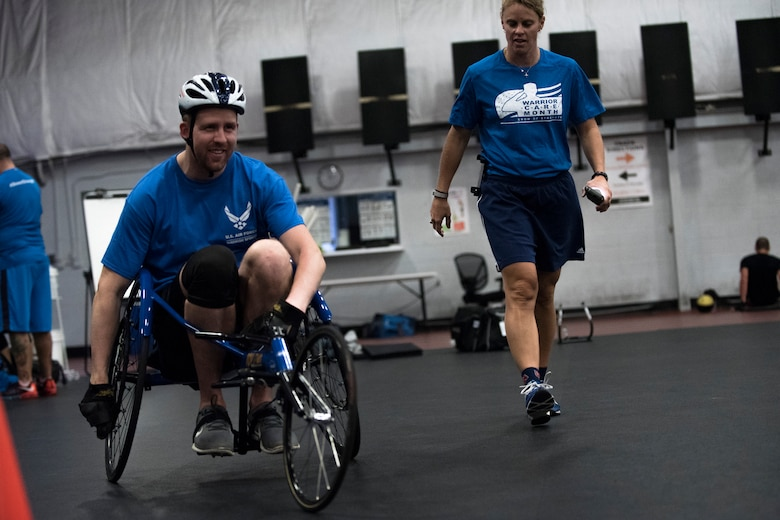 Retired Staff Sgt. Garrett Pope, from Washington state, uses a racing wheel chair for the first time during the Northeast Region Warrior CARE Event at Joint Base Andrews, Md., Nov. 18, 2015. November is Warrior Care Month and dedicated to honoring wounded, ill and injured service members, their families and their caregivers. (U.S. Air Force photo/Airman 1st Class Philip Bryant)