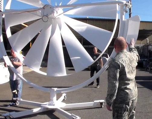 Natural Power Concepts personnel and Lt Col Scott Fitzner of the AFRL Materials and Manufacturing Directorate inspect the Spoke Wheel Medium Wind Power System, one of a number of energy-harvesting technologies being installed as part of the five-year, $20M cooperative agreement with AFRL that will establish a microgrid demonstration project at Joint Base Pearl Harbor-Hickam in Hawaii.  (Photo courtesy of Hawaii Center for Advanced Transportation Technologies)