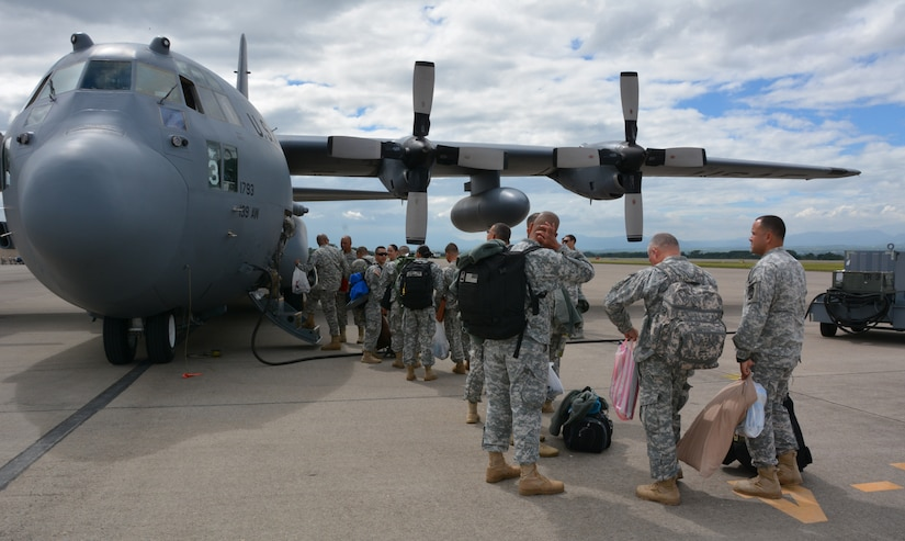 Joint Security Forces members from Soto Cano Air Base, Honduras, board a C-130H Hercules during their redeployment to Puerto Rico, Nov. 19, 2015, after completing a deployment in Honduras. The JSF members were stationed in Honduras for nine months before swapping out with a new unit. (U.S. Air Force photo by Martin Chahin/Released)