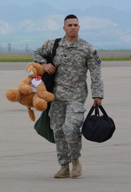 U.S. Army Staff Sgt. Marcos DeJesus, Joint Security Forces member, Soto Cano Air Base, Honduras, boards a C-130H Hercules during his redeployment to Puerto Rico, Nov. 19, 2015, after completing a deployment in Honduras. The JSF members were stationed in Honduras for nine months before swapping out with a new unit. (U.S. Air Force photo by Martin Chahin/Released)