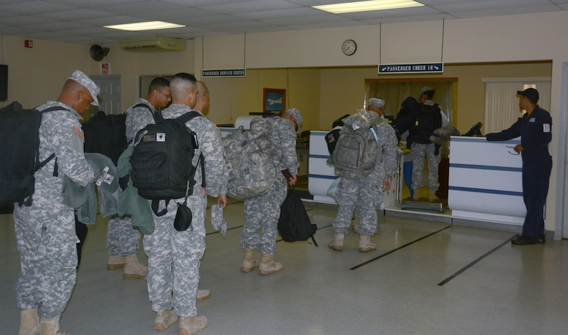 Joint Security Forces members from Soto Cano Air Base, Honduras, prepare to re-deploy to Puerto Rico, Nov. 19, 2015, after completing their deployment in Honduras. The JSF members were stationed in Honduras for nine months before swapping out with a new unit. (U.S. Air Force photo by Martin Chahin/Released)