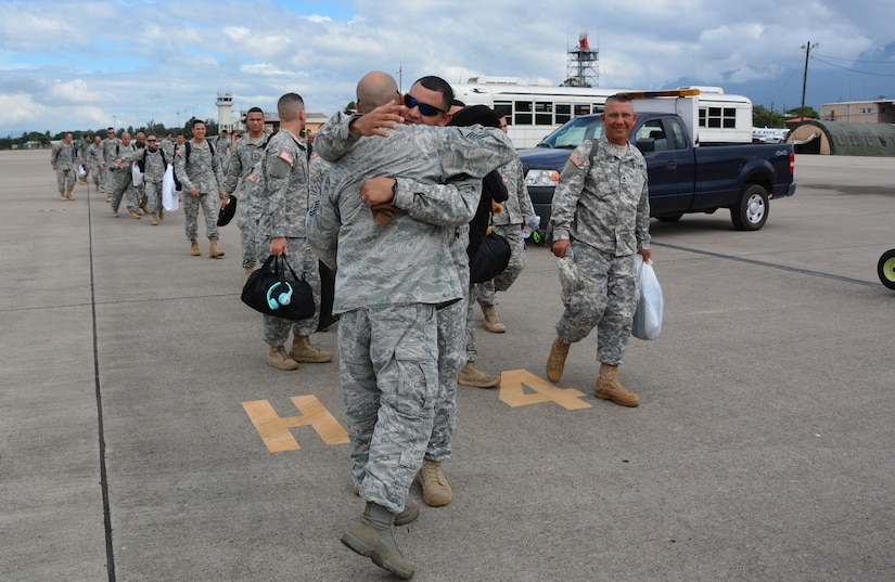 Joint Security Forces members say farewell to friends at Soto Cano Air Base, Honduras, as they board a C-130H Hercules to redeploy to Puerto Rico, Nov. 19, 2015. The JSF members, from Puerto Rico, were stationed in Honduras for nine months before swapping out with a new unit. (U.S. Air Force photo by Martin Chahin/Released)