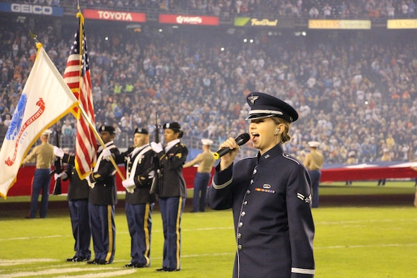 Airman 1st Class Michelle Doolittle, right, U.S. Air Force Band of the Golden West vocalist, sings The Star-Spangled Banner Nov. 9 at Qualcomm Stadium in San Diego, Calif. The performance was part of the San Diego Chargers' Salute to Service prior to their Monday Night Football game against the Chicago Bears.