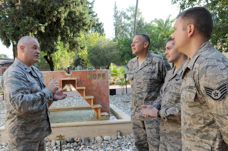 Chaplain (Col.) John Shipman, wing chaplain for the 39th Air Base Wing, speaks with (left to right) Chaplain (Maj.) Stephen Peters and chaplains assistants Tech. Sgt. Paul Santilli and Staff Sgt. Thomas Myers in the chapel garden Nov. 9, 2015, at Incirlik Air Base, Turkey.  As the wing chaplain, Shipman is responsible for all Chaplain Corps personnel, operations and resources supporting the wing mission. He also conducts worship services and observances, provides pastoral care and advises leadership on an array of religious issues. (U.S. Air Force photo by Tech. Sgt. Taylor Worley)