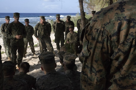CHULU BEACH, TINIAN (November 17, 2015) -  Major Chris Merrill, Marine Corps Activity Guam Planning Representative, conducts professional military education on the realignment of Marines to the Pacific region with Marines of 1st Battalion, 2d Marine Regiment, Tinian, Commonwealth of the Northern Mariana Islands, on Nov. 17th, 2015.  The Marines have been deployed on short notice from Fuji to notionally secure the expeditionary airfield and conduct training.  The training allowed the Marines an opportunity to establish long range communications and receive professional military education in order to ensure utilization and validation of the Marianas Islands Range Complex, improve the Marines' understanding and appreciation for unit history, and validate elements of the Alert Contingency MAGTF.