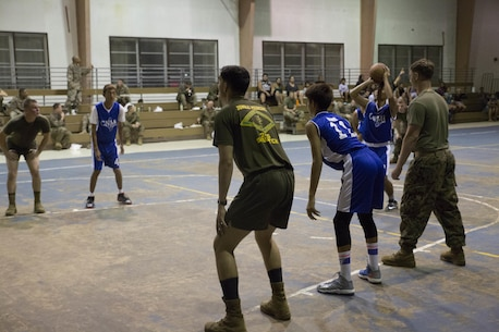 Marines from Company A, B, and C, 1st Battalion, 2d Marine Regiment, took part in a basketball game against the Tinian High School team. The Marines took part in community relations efforts with the people of Tinian, Commonwealth of the Northern Mariana Islands, on Nov. 17, 2015, after being deployed on short notice from Fuji to notionally secure the expeditionary airfield and conduct training. The training allowed the Marines an opportunity to establish long-range communications and receive professional military education in order to ensure utilization and validation of the Marianas Islands Range Complex, improve the Marines' understanding and appreciation for unit history, and validate elements of the Alert Contingency MAGTF.