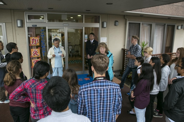Fujimoto Toshifumi, owner of the Kaede Nursing Home in Iwakuni, Yamaguchi, Japan, greeted the National Honor Society students at the front door during their visit to the home, Nov. 17, 2015. Nineteen students visited the Kaede Nursing Home as a way to give back to the local community, experience a new culture and make new friends. Community relation events like this serve as an opportunity to strengthen the friendship between the station residents and the surrounding community.