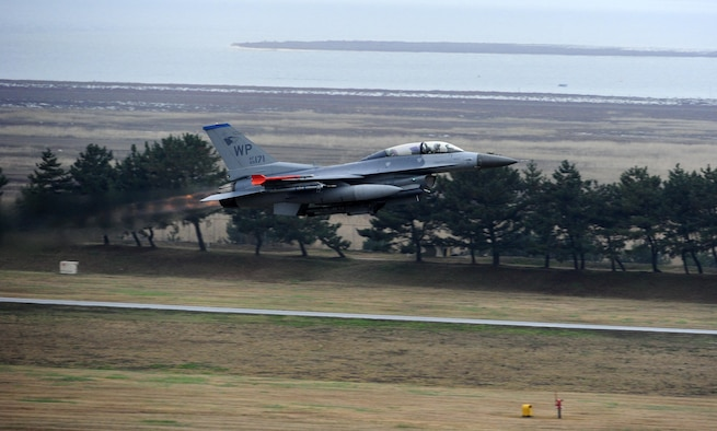 An F-16 Fighting Falcon from the 8th Fighter Wing prepares for takeoff as part of Buddy Wing 15-7 at Kunsan Air Base, Republic of Korea, Nov. 19, 2015. Buddy Wing is part of a bilateral fighter exchange program designed to improve interoperability between U.S. Air Force and ROKAF fighter squadrons and are conducted multiple times throughout the year in order to promote cultural awareness and sharpen combined combat capabilities. (U.S. Air Force photo by Staff Sgt. Nick Wilson/Released)