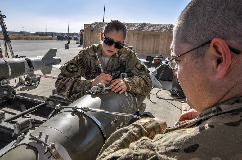 Staff Sgt. Samuel Percy and Airman Morgan Matteson, both from the 455th Expeditionary Maintenance Squadron munitions flight, deployed from Hill Air Force Base, Utah, assemble a GBU-54 500 pound bomb at Bagram Airfield, Afghanistan, Nov. 17, 2015. The AMMO flight provides necessary weapons and countermeasures required to project combat airpower. (U.S. Air Force photo by Tech. Sgt. Nicholas Rau/Released)
