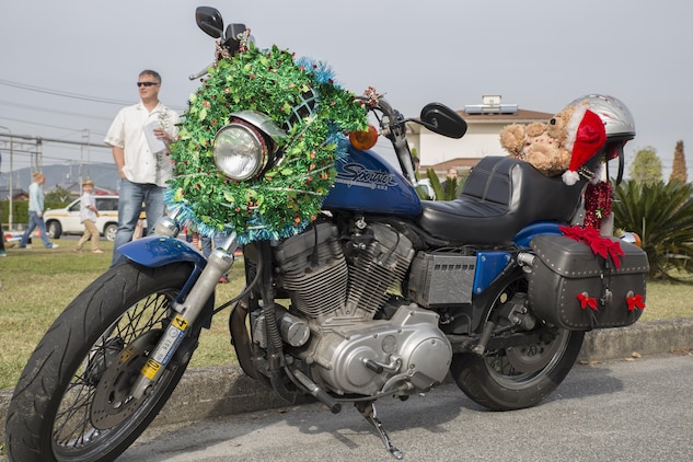 Japanese motorcycle clubs and motorcycle riders from the air station gathered at the Marine Thrift Store for the third-annual Toy Drive and Motorcycle Rally at Marine Corps Air Station Iwakuni, Japan, Nov. 22, 2015. Station residents and local Japanese donated toys for Japanese orphans and enjoyed decorated bikes and the roar of engines as the motorcyclists went on a Thunder Ride around base.