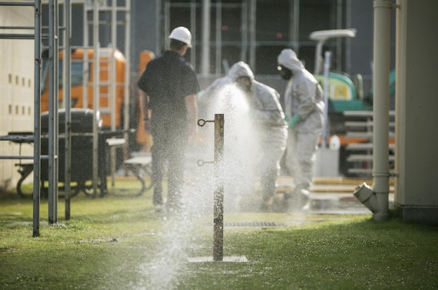 Participants of the Hazardous Material Awareness and Operations course practice operating a fire hose during the course at Marine Corps Air Station Iwakuni, Japan, Nov. 19, 2015. Being on a military installation, service members may come into contact with hazardous materials such as weapons, explosives and fuels as well as common household chemicals used on base such as chlorine found in pools or even cleaning products; so service members and firefighters trained for recognition as first responders in a hazardous material incident during the course.