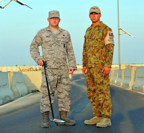 "Senior Airman Justin, 380th Expeditionary Security Forces Squadron base defense operations controller, and Corporal Mitchell Goldsmith, Combat Support Unit 14 security forces operator with the Royal Australian Air Force, pose for a photo at an undisclosed location Southwest Asia Oct. 21, 2015. ""The highlight my experience has been just getting to know them,"" said Justin. ""It's a really fun group of Aussies that we have here. They're not 100 percent work and zero fun; they do the job and have fun while doing it."" (U.S. Air Force photo/Staff Sgt. Kentavist Brackin)"