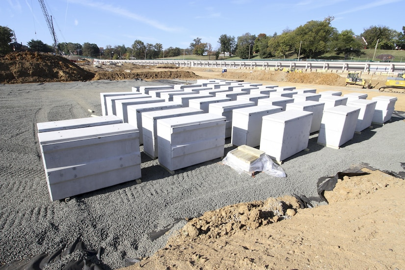 ARLINGTON, Va. -- Double-depth concrete liners are prepositioned on site at Arlington National Cemetery's Millennium Project here October 20, 2015. The liners are a first for the cemetery, which in the past placed single-depth concrete liners into burial spaces just prior to a funeral service. The new system presets the liners at 18 inches below the surface, allows for two caskets to be placed inside and increases efficiency when prepping a plot for burial. Learn more about the Millennium Project at http://bit.ly/MillenniumProj. (U.S. Army photo/Patrick Bloodgood)