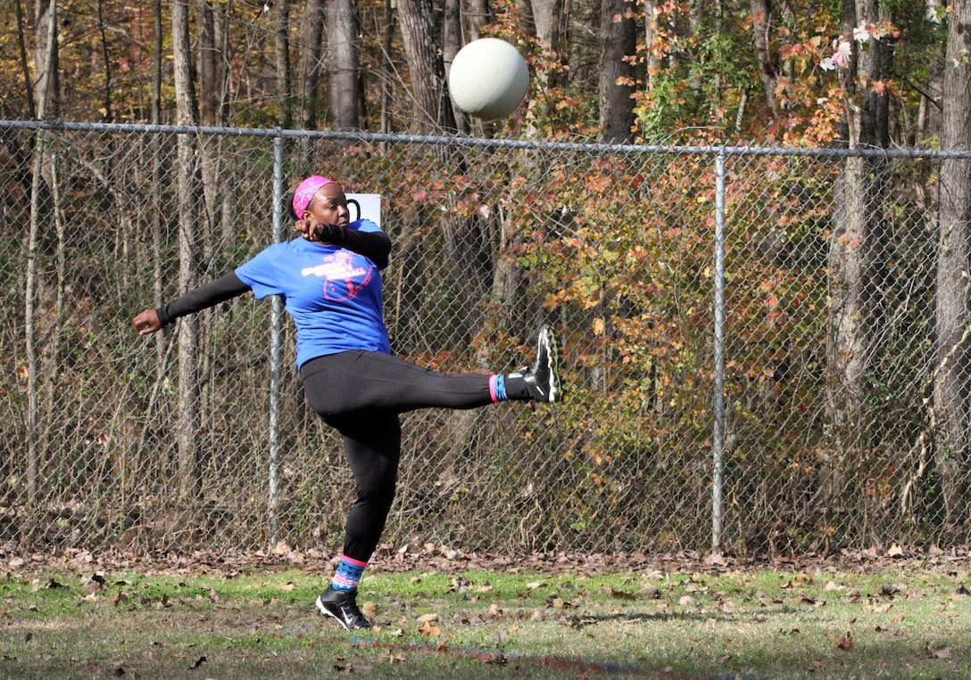 """Staff Sgt. Gretta Smith, an executive administrative assistant with the 108th Training Command (Initial Entry Training) kicks the ball during a practice kickball game Nov. 15, 2015, at Clanton Park in Charlotte, N.C. Smith plays with an all-female kickball team which is part of the """"Ladies under the Lights"""" kickball league as a way of interacting with her community. (U.S. Army photo by Sgt. Javier Amador)"""