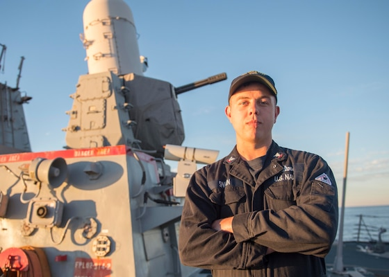 Navy Petty Officer 3rd Class Tyler Swain, a fire controlman deployed aboard the guided missile destroyer USS Bulkeley, recently pulled a man from a wrecked vehicle following a high-speed collision in Norfolk, Va., Nov. 15, 2015. U.S. Navy photo by Petty Officer 3rd Class M. J. Lieberknecht