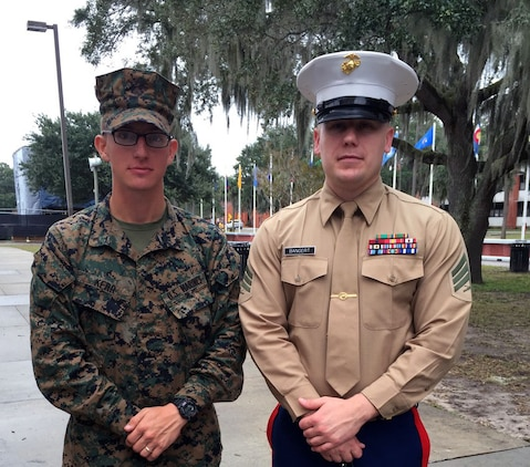 Pfc. Michael Kerr, left, stands with his recruiter, Sgt. Christopher Bangert, during a family day at Marine Corps Recruit Depot Parris Island, Nov. 19. Kerr, a Lynchburg native, graduated as the Hotel Company honor man, meaning he was the top recruit to graduate from the company. Kerr, 23, will be a trumpet player for the Marine Corps Band. (Courtesy Photo)