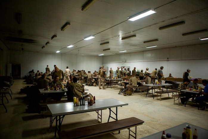 U.S. service members with Task Force Al Taqaddum sit down for a meal provided by the food service specialists at Al Taqaddum Air Base, Iraq, Nov. 7, 2015.  The food service members wake before the sun and toil into the late hours of the night to continue to provide support to U.S. and coalition forces in their day-to-day operations in support of Combined Joint Task Force-Operation Inherent Resolve. (U.S. Marine Corps photo by Sgt. Owen Kimbrel)
