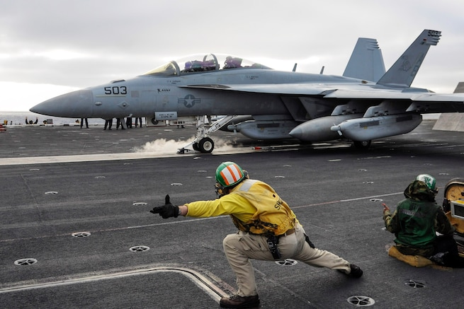 An E/A-18G Growler launches off the flight deck of the aircraft carrier USS Theodore Roosevelt in the Pacific Ocean, Nov. 21, 2015. The Growler is assigned to Electronic Attack Squadron 137. U.S. Navy photo by Petty Officer Seaman Chad M. Trudeau