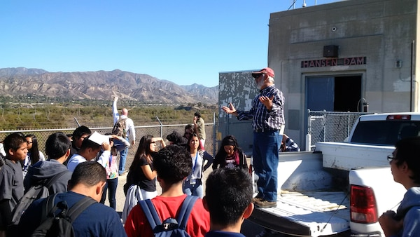 Dam Operations Supervisor Louis Munoz talks to area high school students about the operation of Hansen Dam, a U.S. Army Corps of Engineers Los Angeles District flood risk reduction project located in the San Fernando Valley, during a tour of the basin Nov. 19.