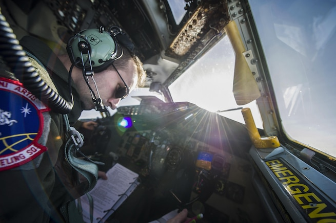 Air Force 1st Lt. Steven Strickland sits in the copilot seat during an air refueling mission over Oregon, Nov. 16, 2015. Strickland is a copilot with the 93rd Air Refueling Squadron. U.S. Air Force photo by Airman 1st Class Sean Campbell
