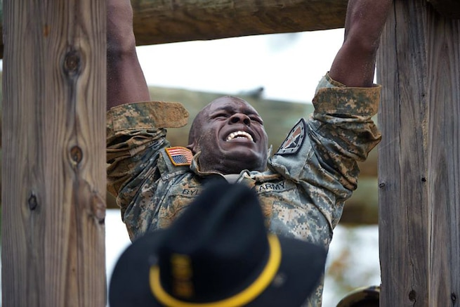 A soldier navigates an obstacle on Fort Benning, Ga., Nov. 18, 2015. The soldier is assigned to the 316th Cavalry Brigade, U.S. Army Armor School. U.S. Army photo by Patrick A. Albright