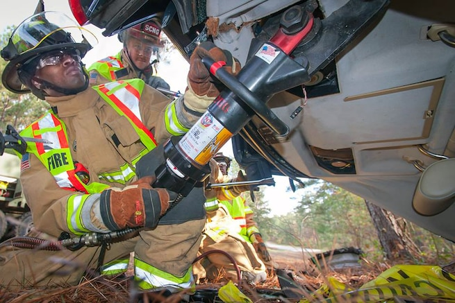 Army firefighters respond to a simulated accident scene during an auto extraction exercise on McCrady Training Center near Eastover, S.C., Nov. 15, 2015. The firefighters are assigned to the South Carolina Army National Guard. U.S. Army photo by Sgt. Brian Calhoun